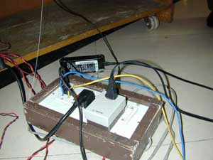 raw wires inserted in electrical outlet